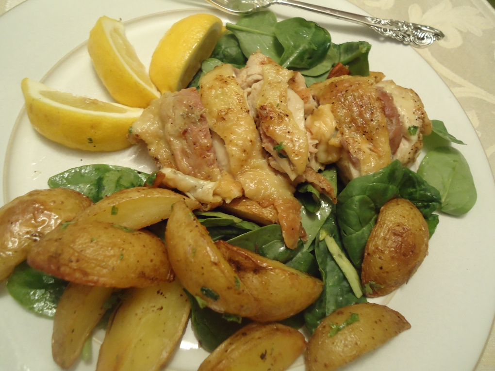 Prosciutto, Fontina and Rosemary Stuffed Chicken Thighs on a bed of Baby Spinach with Garlicky Roasted Potatoes