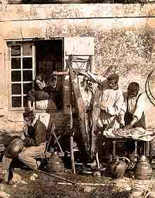 Pork being prepared in France in 1850. Photography by Louis Humbert de Molard (1800-1874).