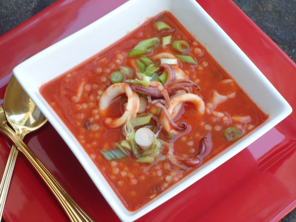 Calamari and Tomato Soup With Couscous and Caperberries