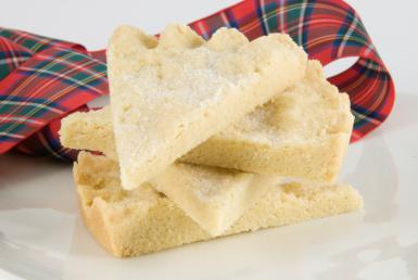 pile of shortbread with red tartan ribbon