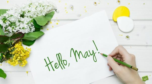 Hello-May.-On-pic-of-girl-writting-on-blank-paper-with-flowers-on-the-side